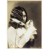 Japanese Woman Curling Hair