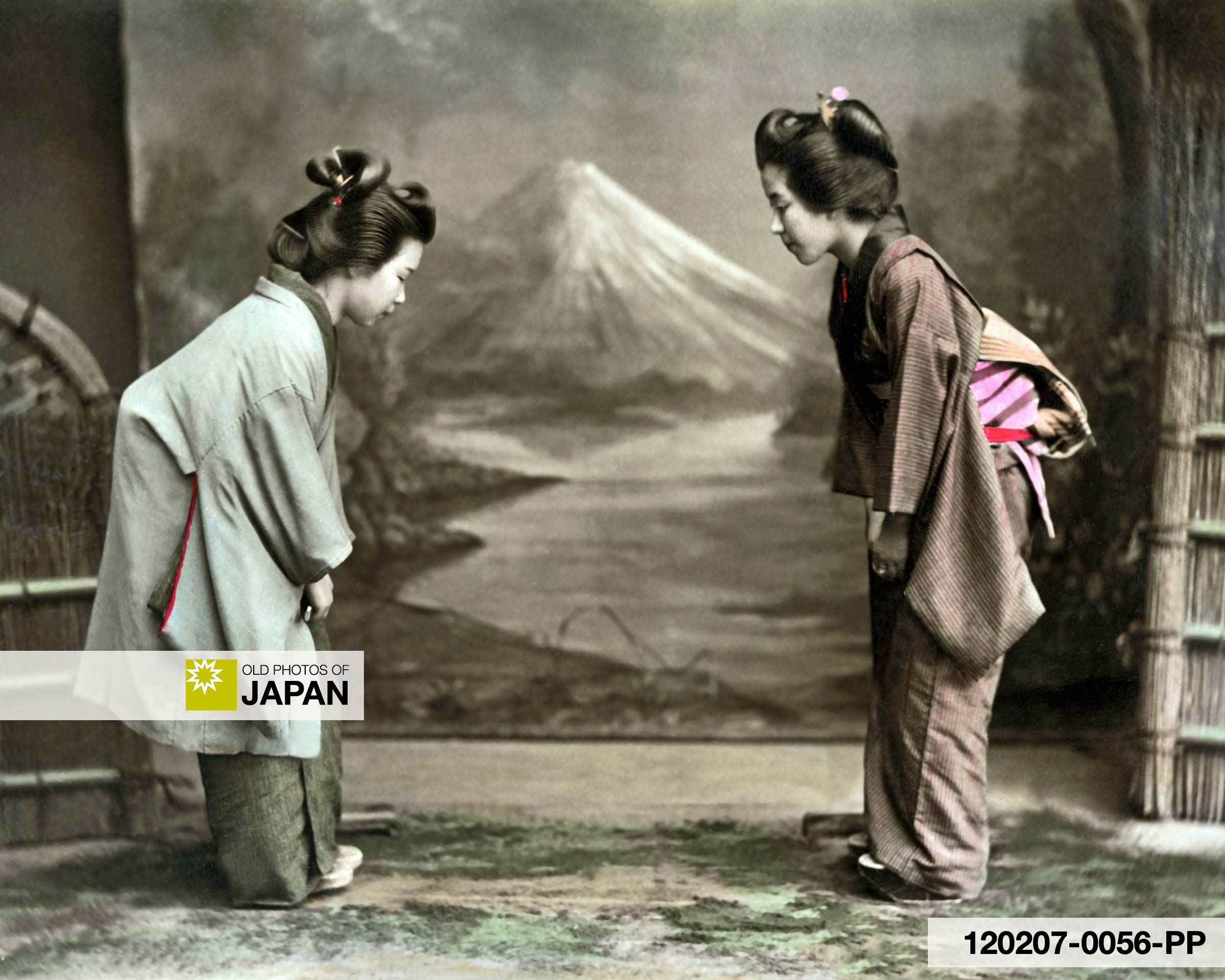 Two women bowing to each other.