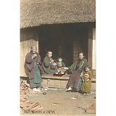 Japanese Family in Traditional Clothing Having Tea