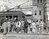 Men and Women Getting on Street Car in Tokyo, Japan (May 1934).