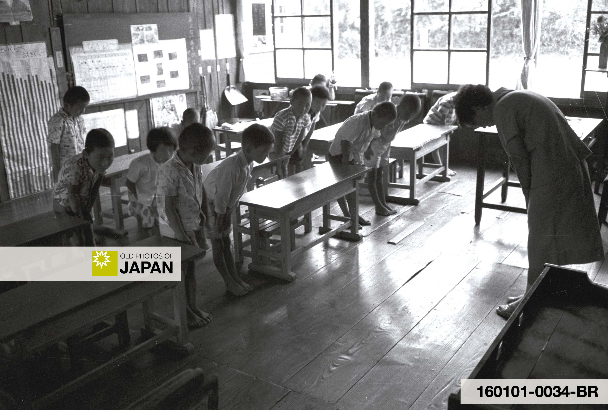 Children and a teacher bow to each other, 1960