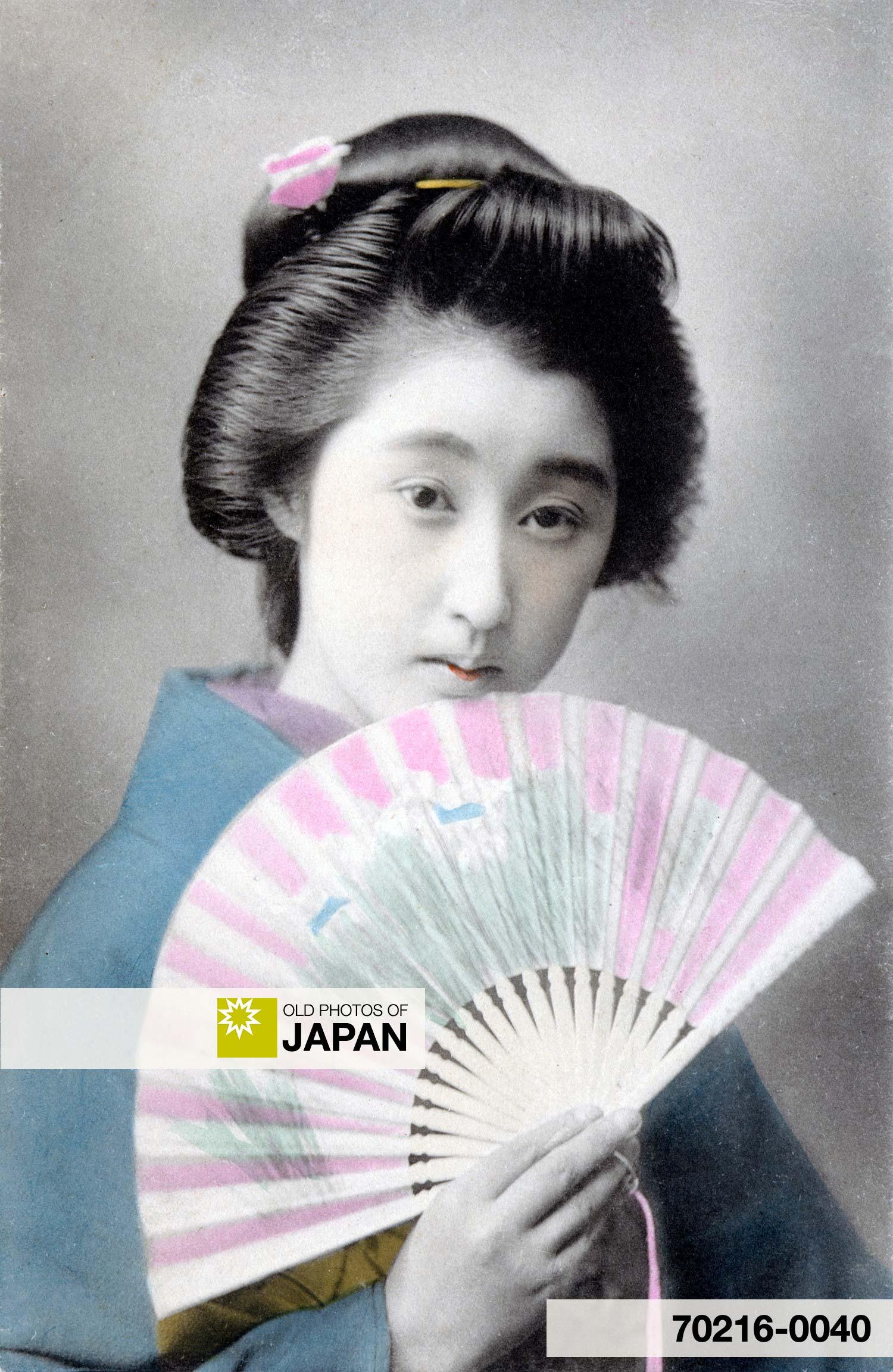 Japanese Woman in Kimono Holding a Fan